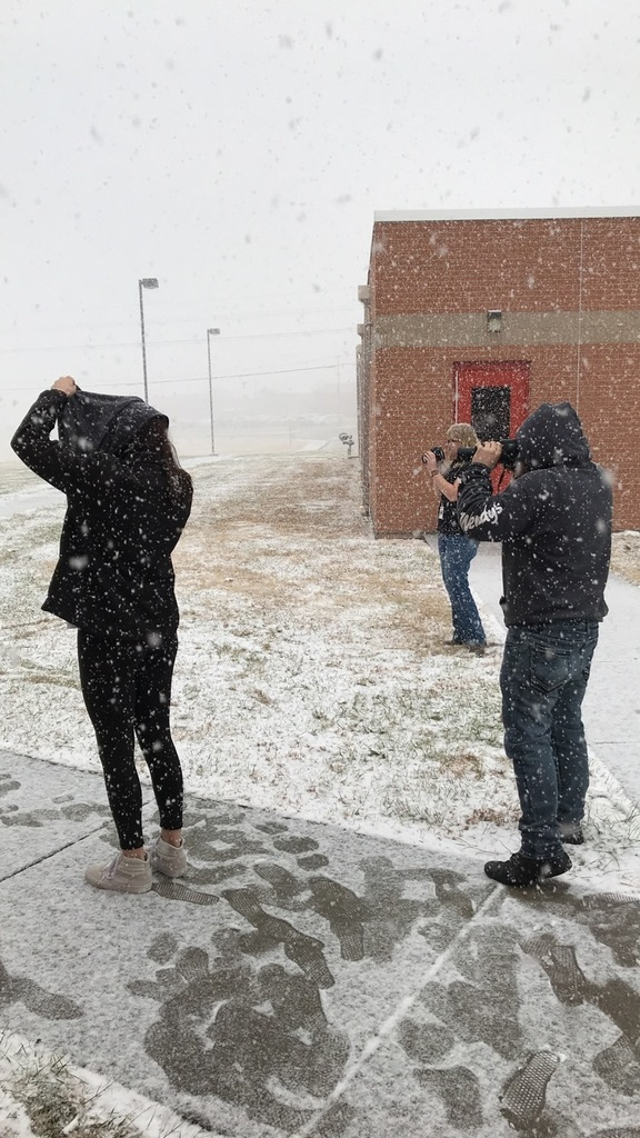 students taking photos in snow